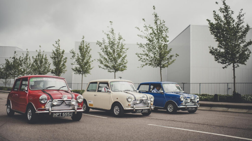 Three Minis from the iconic Italian Job line up as three famous movie cars.