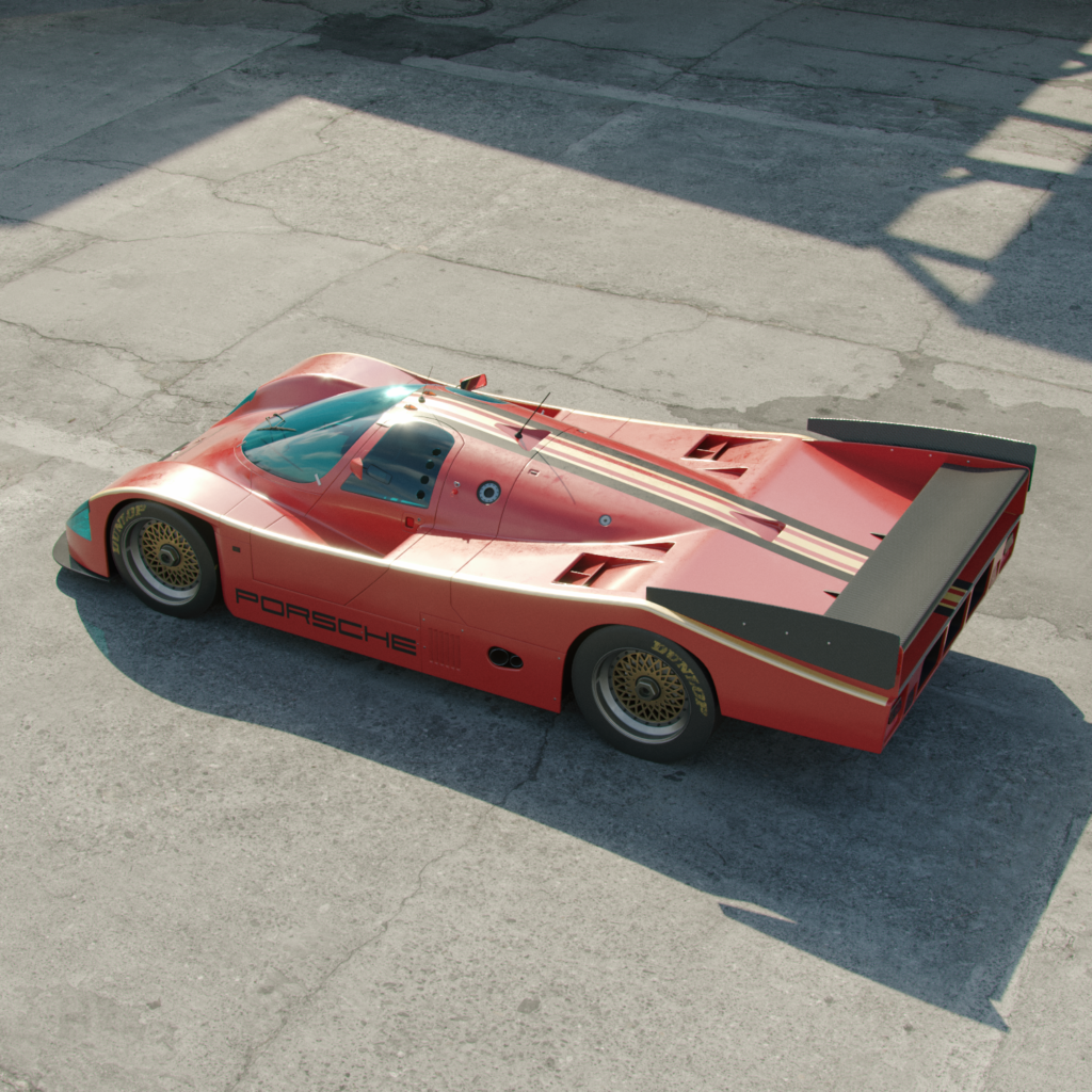 a porsche 962 graphic design car reinvented, appearing in direct sunlight on tarmac.